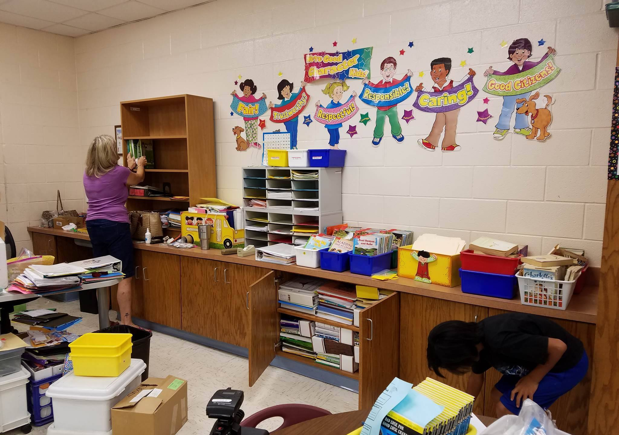 HCISD 3rd Grade Teacher Laura Anderson organizes her classroom before the start of the new school year.